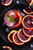Refreshing cocktail with red blood orange, ice and mint. Top view royalty free stock photo