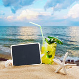 Refreshing cocktail on the sea sand Stock Image