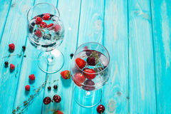 Refreshing cocktail with vodka martini with ice and berries on wood table. Copyspace Royalty Free Stock Photography