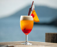 Refreshing cocktail on wooden table by the sea Royalty Free Stock Photography