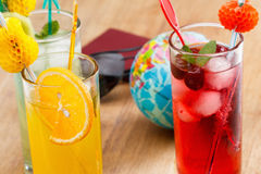 Refreshing cocktails and Globe, concept Stock Photos