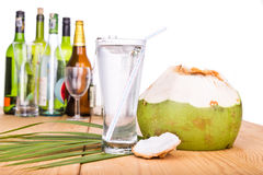 Refreshing coconut fruit juice re-hydrates and helps relief alco Stock Images
