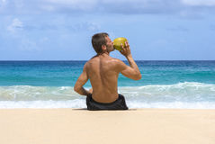 Refreshing coconut water by the sea Royalty Free Stock Images