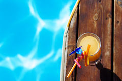 Refreshing coctail near swimming pool on vacation. Cool refreshing coctail near swimming pool on vacation Royalty Free Stock Photo