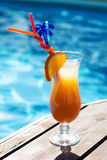 Refreshing coctail near swimming pool on vacation Stock Images