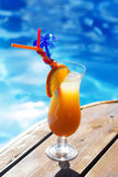 Refreshing coctail near swimming pool on vacation Stock Photo