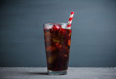 Refreshing cold cherry cola. On the wooden background Stock Images