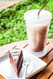 Refreshing with cold coffee and chocolate cake. Refreshing break with cold coffee and chocolate cake Stock Images