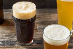 Refreshing Cold Craft Beer Assortment. Of IPA Lager and Stout stock images