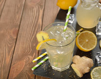 Refreshing cold lemonade with ginger. On a brown background Royalty Free Stock Photos