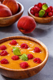 Refreshing cold peach soup garnished with raspberries and mint l Royalty Free Stock Image