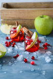 Refreshing cranberry drink with apples Royalty Free Stock Photo