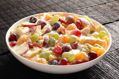 Refreshing creamy fruit salad served in bowl, Royalty Free Stock Photography