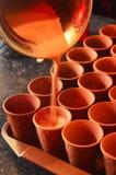Refreshing cutting Chai or tea in mud cups.  stock photo