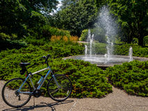Refreshing cycle ride. Cycle alongsode Botanical Garden fountain, Peoria, Illinois stock image
