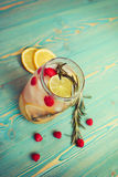 Refreshing detox water with fruits in jar on wooden table Royalty Free Stock Photos