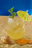 Refreshing drink on the beach Royalty Free Stock Photo