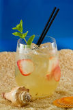 Refreshing drink on the beach Stock Photo