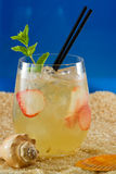 Refreshing drink on the beach Royalty Free Stock Images