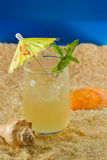 Refreshing drink on the beach Royalty Free Stock Image