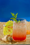 Refreshing drink on the beach Stock Images