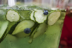 A refreshing drink with cucumber slices and blueberries in a mis. Mojito. Refreshing drink with cucumber slices and blueberries Royalty Free Stock Photography