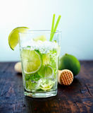 Refreshing drink with fresh lime slices. Refreshing cold Caipirinha with fresh lime slices and ice Royalty Free Stock Image