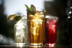 Refreshing drink glasses. Detail of several glasses filled with refreshing, tasty drinks Royalty Free Stock Images