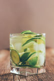Refreshing drink with green lemon and ice close up Royalty Free Stock Images