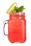 Refreshing drink in a jar mug on a white background. Cocktail with watermelon juice and a slice of watermelon and mint as a decora Stock Photography