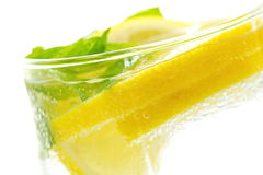 Refreshing drink with lemon, ice and mint Stock Image