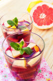 Refreshing drink with lots of different fruits Stock Images