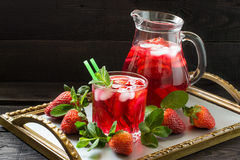 Refreshing drink with strawberries and ice Royalty Free Stock Photography