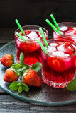 Refreshing drink with strawberries and ice Stock Image