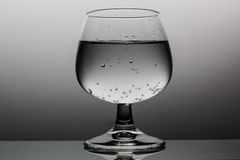 Refreshing drink in Wineglass. Drink in Wineglass with Waterdrops and fizzy Water Royalty Free Stock Image