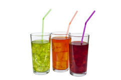 Refreshing Drinks. Three Glasses containing refreshing iced drinks, with straws. Isolated on white Royalty Free Stock Photography