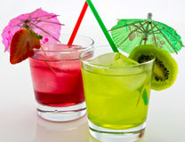 Refreshing drinks with a straw and umbrella. Refreshing kiwi and strawberry drink with a straw and umbrella Stock Image