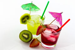Refreshing drinks with a straw, umbrella and fruit. Refreshing kiwi and strawberry drink with a straw, umbrela and fresh strawberry and kiwi Royalty Free Stock Photos