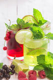 Refreshing drinks and various fresh fruits and berries. On a wooden table Royalty Free Stock Photos