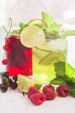 Refreshing drinks and various fresh fruits and berries. On a wooden table Stock Image