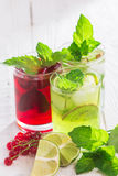 Refreshing drinks and various fresh fruits and berries. On a wooden table Stock Photos