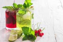 Refreshing drinks and various fresh fruits and berries. On a wooden table Royalty Free Stock Images
