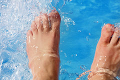 Refreshing the feet in the pool Royalty Free Stock Photo