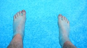 Refreshing feet in a pool Royalty Free Stock Images