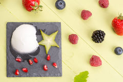 Refreshing frozen sorbet on table with fresh fruits. Frozen sorbet with mixed fresh fruits on table royalty free stock image