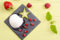 Refreshing frozen sorbet on table with fresh fruits. Frozen sorbet with mixed fresh fruits on table Stock Photos