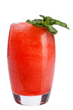 A refreshing fruit cocktail. A refreshing drink with a flesh of red berries, decorated with mint. Isolated stock photography