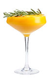Refreshing fruit cocktail. A refreshing drink with a mango pulp, decorated with rosemary. Isolated Stock Photo
