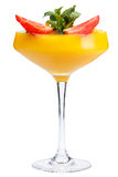 Refreshing fruit cocktail. A refreshing drink with a mango pulp, decorated with strawberries and mint. Isolated stock photo