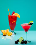 Refreshing fruit cocktails on pastel turquoise background. Copy space stock photo